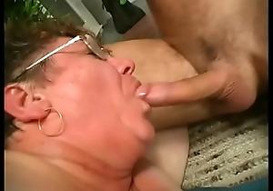 Granny gets jizz above her glasses