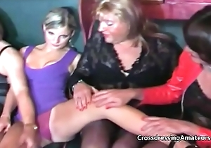 Elder statesman crossdressers with two attractive younger females