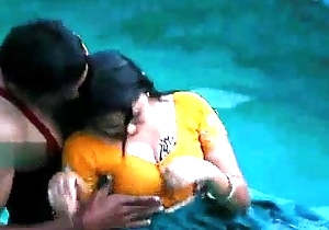 Lovers sexy topic in swimming pool
