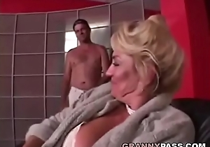 Busty grandma is getting her muff gorged