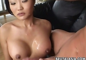 Asian pitch-dark hair bitch sucks plus acquires spoils screwed real coarse