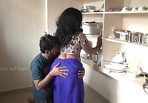 Indian mother and daughter romance in kitchen