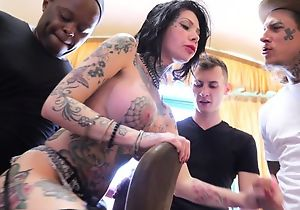 Tattooed bitch with big juggs gets gangbanged in the living room