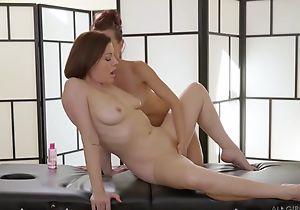 Two insatiable lesbians trample passionately via a rub-down