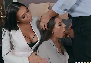 Two glamorous brunettes pleasuring Keiran down bed