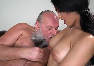 Pretty brunette with big naturals fucks an daddy